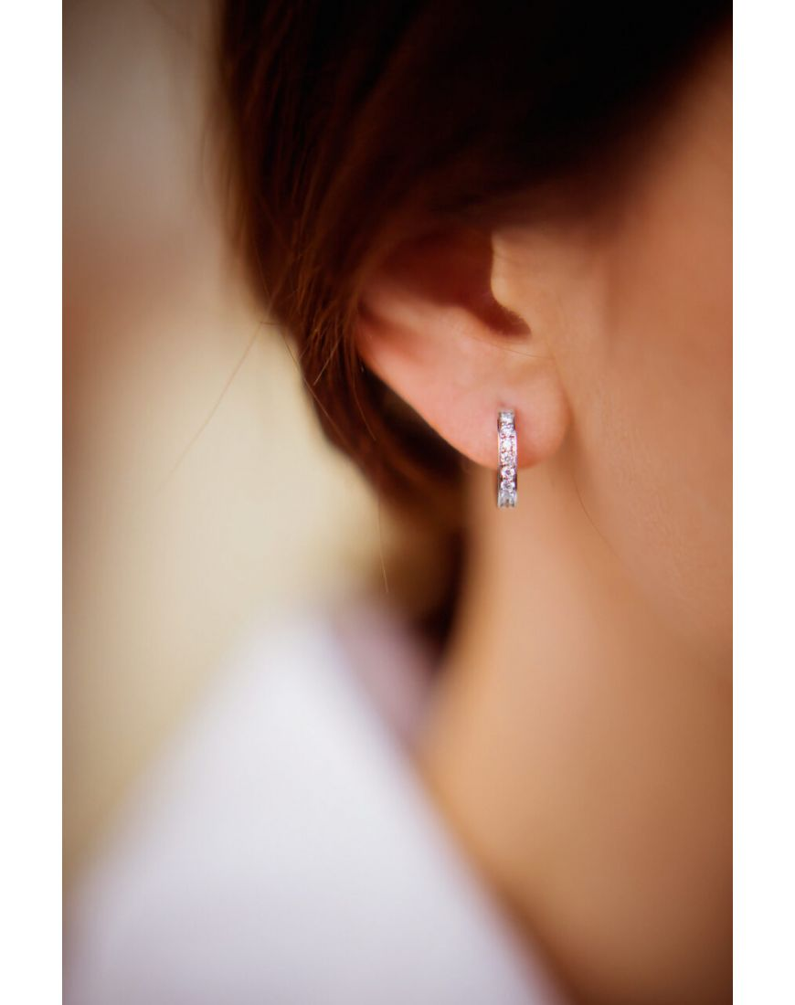 14K Gold hoop earrings with diamonds.