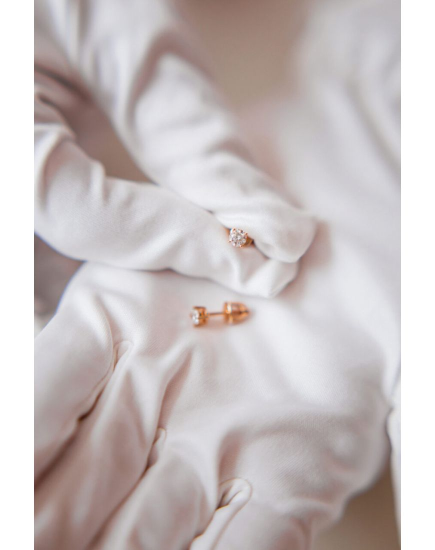 Solitaire diamond stud earrings